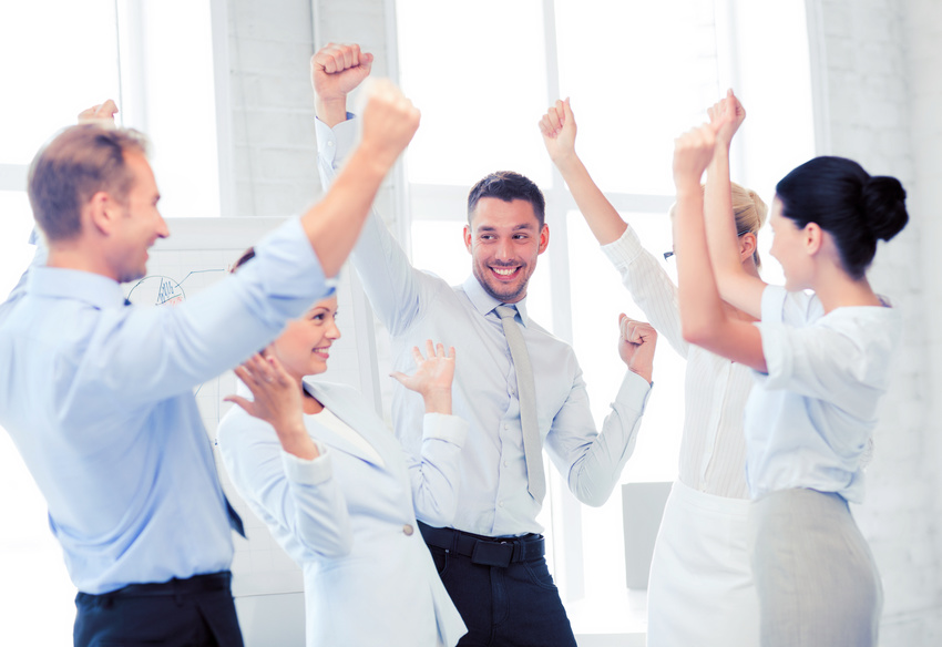 business team celebrating victory in office